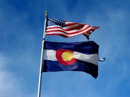 CO State Flag with US Flag on Pole